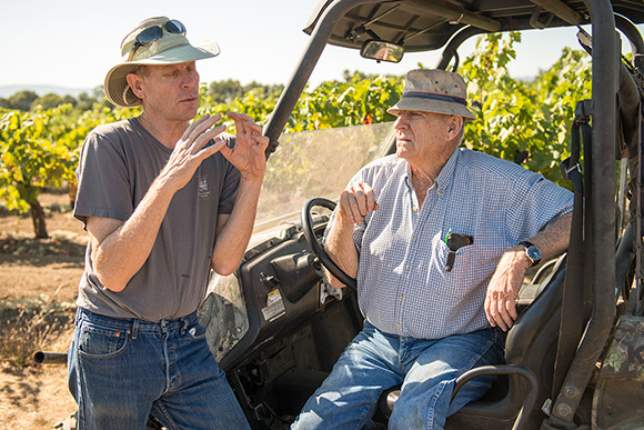Jim, Navarro's winemaker, and Ed Pallini, grape grower, in conversation in Ed's daughter's vineyard.
