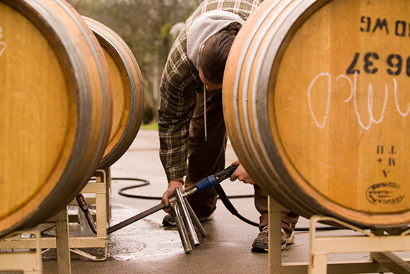 Cleaning a barrel with winery equipment