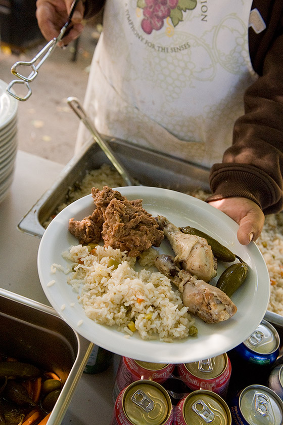 A plate of homecooked chicken, rice and peppers, served to the vineyard crew for breakfast after picking grapes at night.