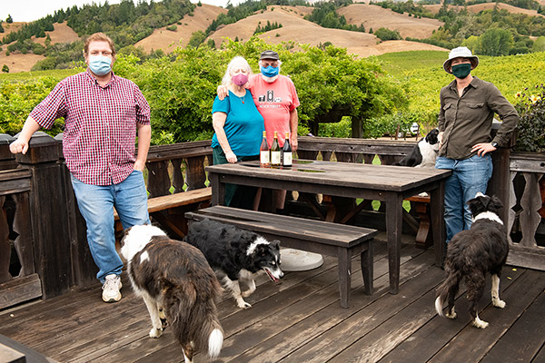 Bennett-Cahn family with masks and dogs